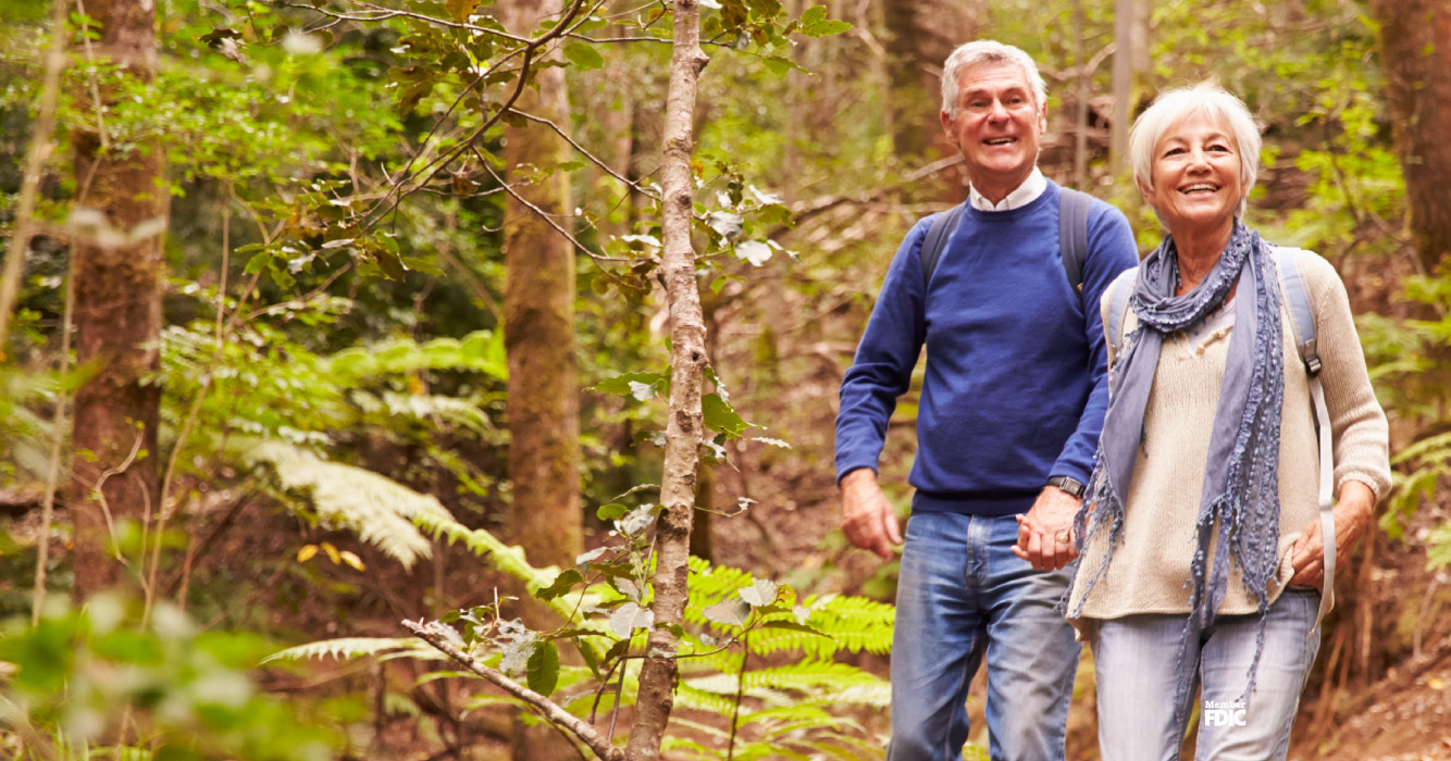 Mature couple enjoying their hike through the woods.